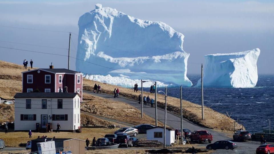 The icebergs are often locked into sea ice, which can last until late spring or early summer, but this one looks like it has grounded and could remain in place, Mayor Adrian Kavanagh told The Canadian Press. (Jody Martin / REUTERS)