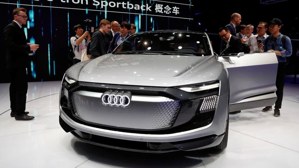 People gather around the Audi e-tron Sportback concept car at the Shanghai Auto Show during its media day on Wednesday. (Reuters)