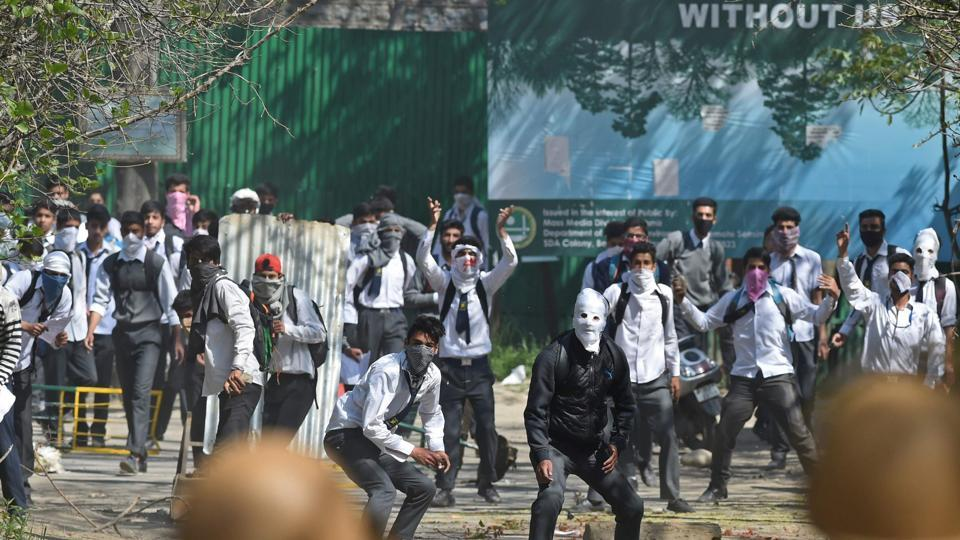Kashmiri students clash with security forces near a college in central Srinagar's Lal Chowk on April 17.