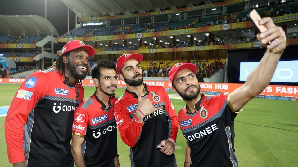 Royal Challengers Bangalore players (starting from left) Chris Gayle, Yuzvendra Chahal, Virat Kohli and Mandeep Singh click a selfie after their 21-run win over Gujarat Lions.   (BCCI )