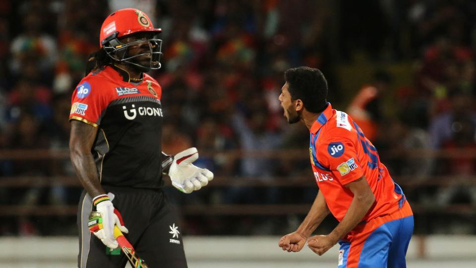 Basil Thampi of the Gujarat Lions (GL) celebrates the wicket of Chris Gayle of Royal Challengers Bangalore (RCB) during their 2017 Indian Premier League (IPL) match at the Saurashtra Cricket Association Stadium in Rajkot on Tuesday.