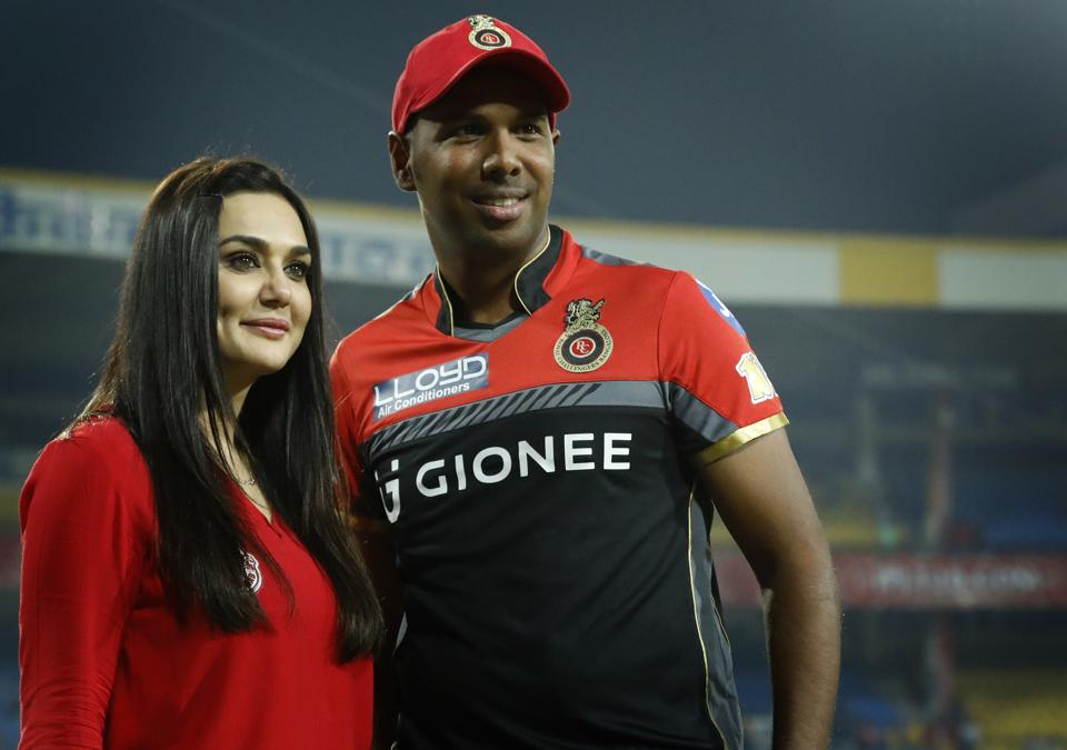 Preity Zinta with Samuel Badree of the Royal Challengers Bangalore after Kings XI Punjab's match against the Virat Kohli-led team on April 10. (BCCI/Sportzpics)