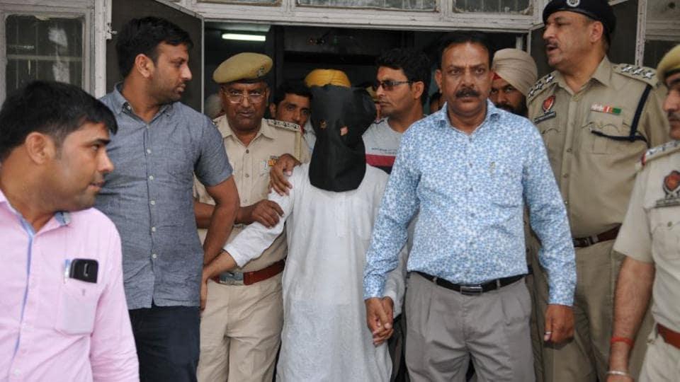 The suspect Muzzamil Khan in police custody on Thursday.