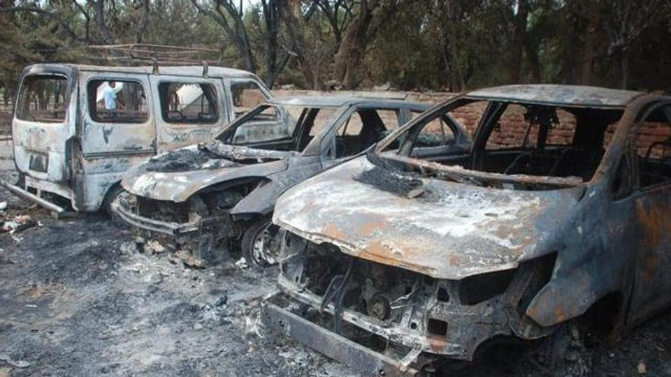Charred remains of Luxury vehicles, trucks, tractors and motorcycles lie inside Jawahar Bagh.