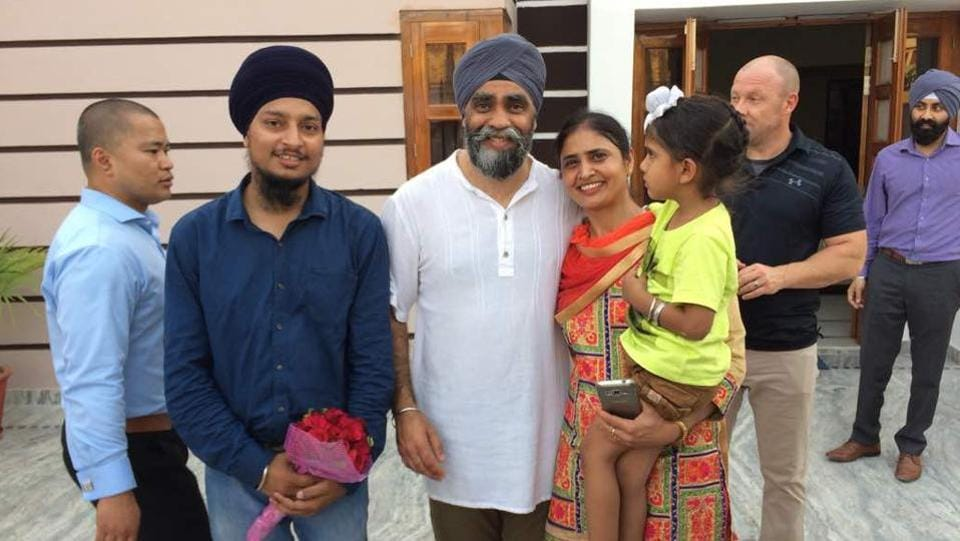 Sajjan greeting his relatives at his house in Bombeli village on Thursday. (HT Photo)