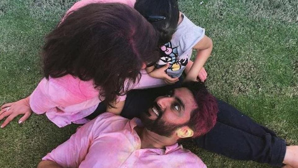 Abhishek and Aishwarya with their daughter Aaradhya after a good time playing holi.