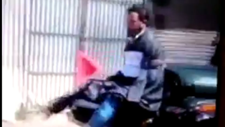 """The man in the video says he """"voted for democracy"""" and that he was not pelting stones at the forces."""