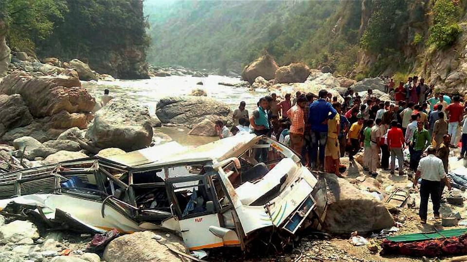 Rescue work in progress after a private bus fell in Tons river in Nerwa near Chaupal, Himachal Pradesh on Wednesday.