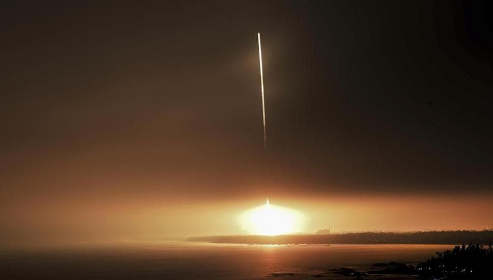 In this photo released by Xinhua News Agency, a Long March 7 rocket carrying the Tianzhou 1 cargo spacecraft blasts off from the Wenchang Space Launch Center in Wenchang in southern China's Hainan Province, Thursday, April 20, 2017. China has launched its first unmanned cargo spacecraft Thursday on a mission to dock with the country's space station.