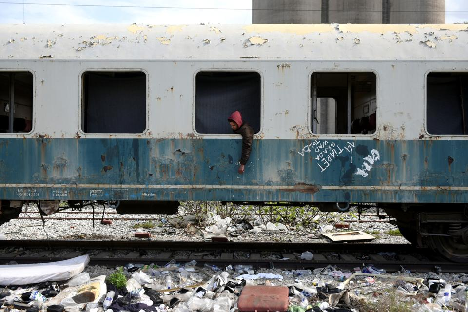 Habib, 22, from Algeria sits in an abandoned railway wagon used as a shelter by stranded migrants in the northern city of Thessaloniki, Greece. Habib arrived at the Greek island of Rhodes three months ago and he reached the mainland after hiding in a truck on a passenger ferry to Athens.  (Alexandros Avramidis  /Reuters)