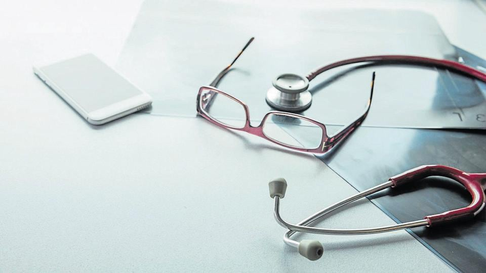 A Doctor's desk with a stethoscope.