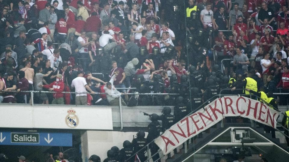 Riot police clash with Bayern Munich fans in the tribunes during the UEFA Champions League quarter-final second leg football match at Real Madrid's Santiago Bernabeu stadium on Tuesday.