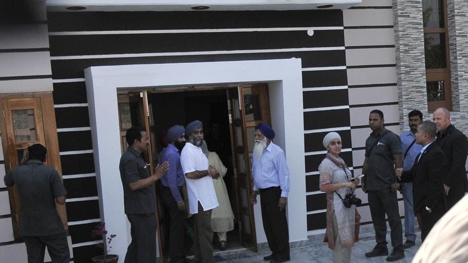Sajjan Singh with his parents at their house in Bombeli village on Thursday. (Ravi Kumar/HT)