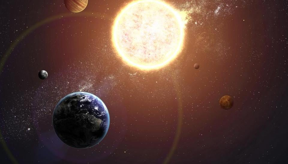An illustration of the solar system shows planets around sun.