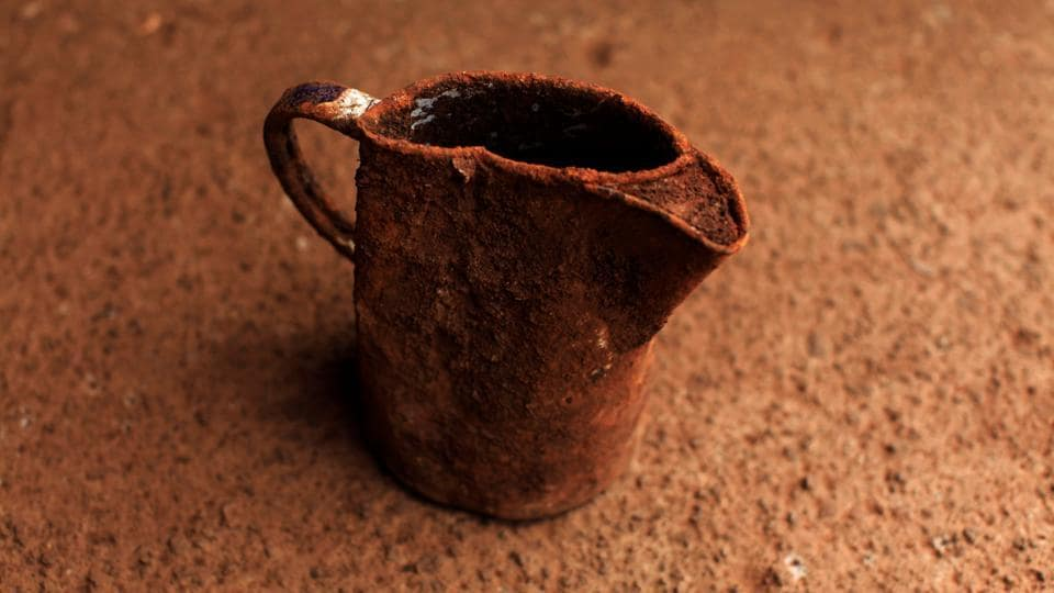 A jug found at an exhumation site. (Jose Cabezas  / Reuters)