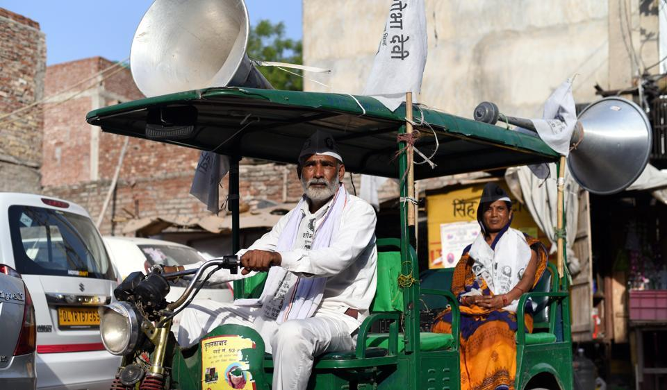 Shobha Devi, an independent candidate from Tughlakabad Village, during the campaign. Her husband,  Subhash Singh, drives her around in the e-rickshaw that he runs for a living.