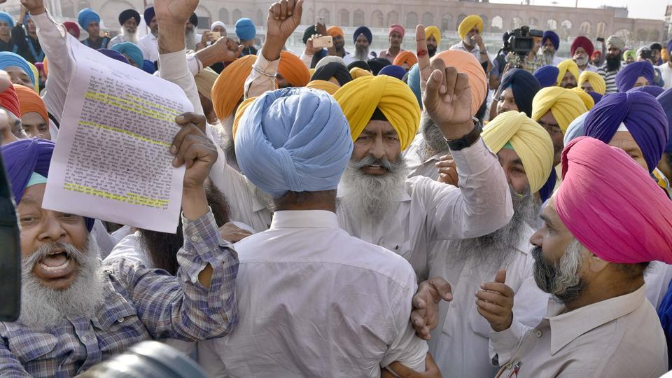 Sajjan's Amritsar visit had its fair share of controversy with members of SAD (Amritsar) raising the slogans against the SGPC during his Golden Temple visit.  (Gurpreet Singh)