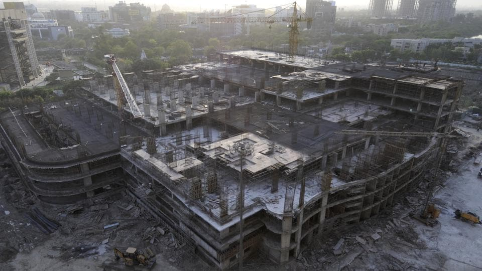 An under construction multi-level parking lot in Noida's Sector 18 market.