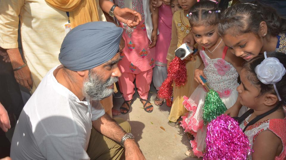 The Canadian defence minister interacting with physically and mentally-challenged Pingalwara residents in Amritsar on Thursday.   (Gurpreet Singh/HT)