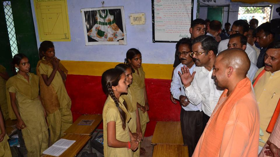 CM Yogi Adityanath interacting with primary school children in Tankori village in Jhansi on Thursday.