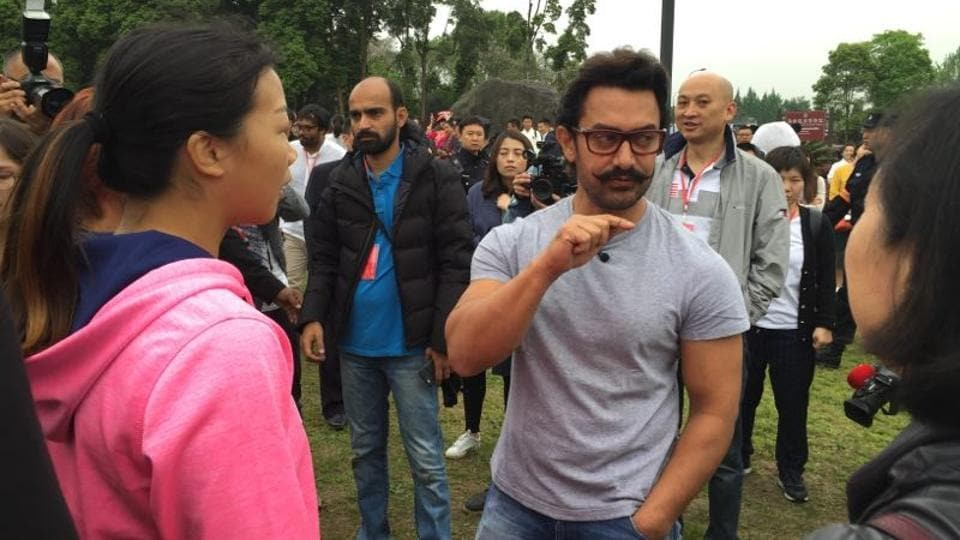 Bollywood star Aamir Khan interacting with members of the Sichuan women's wrestling team in Chengdu, China. The actor was in China to promote his movie Dangal, which will be released in the country on May 6.