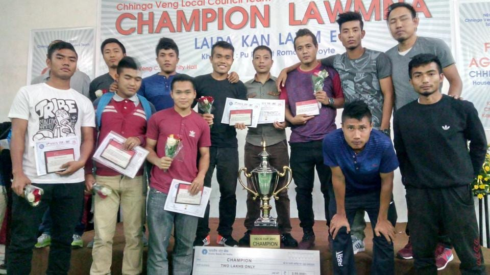 Players of Chinga Veng FC, a community club of Mizoram, posing with the trophy and certificates after winning a popular inter-village and local council championship in the  state.