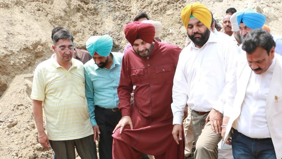 Local bodies minister Navjot Singh Sidhu inspecting the sewerage system in Amritsar on Friday.