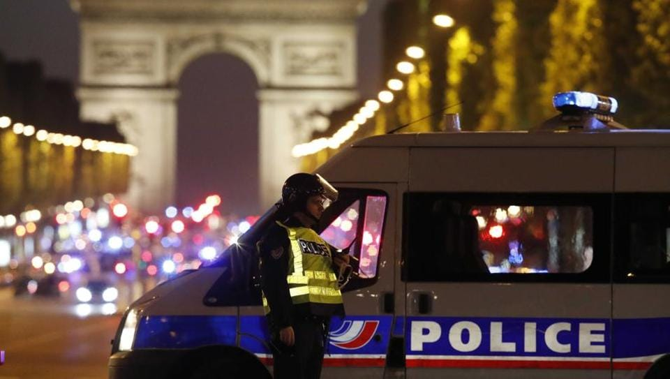 Police secure the Champs Elysees Avenue after one policeman was killed and another wounded in a shooting incident in Paris, France.