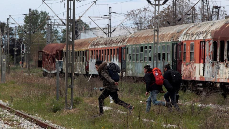 From there, they monitor freight trains heading to central Europe. Whenever trains stop in the station, the migrants try to sneak into their compartments or jump in between wagons. (Alexandros Avramidis  /Reuters)