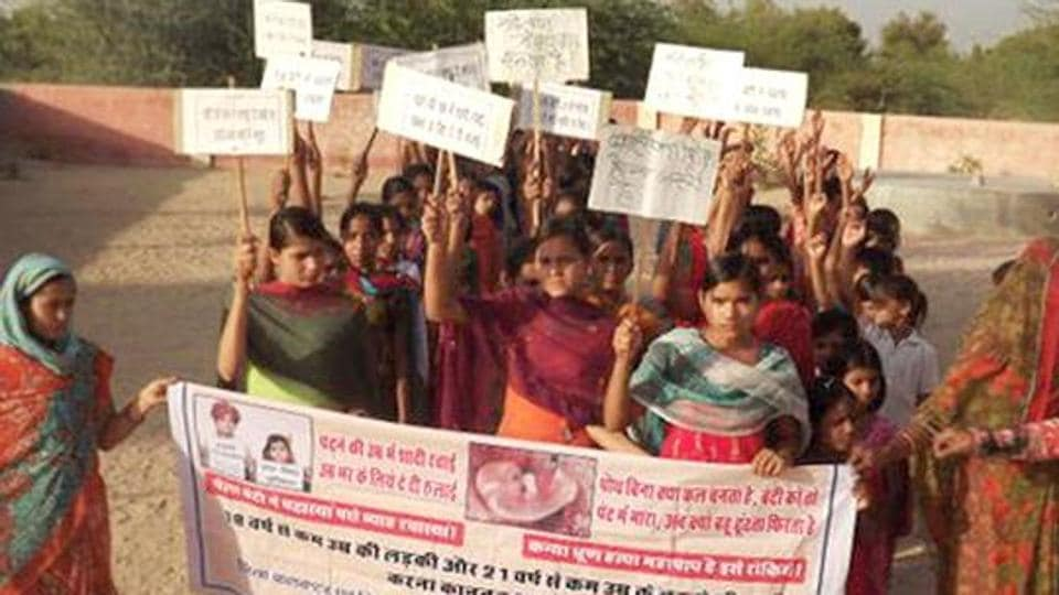 Children take out an awareness rally against child marriage.