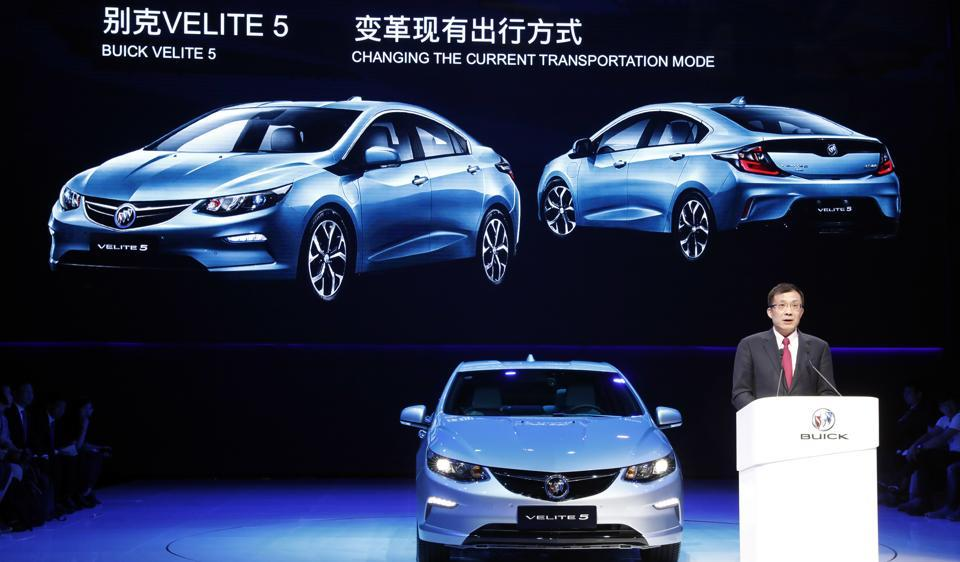 SAIC-GM president Wang Yongping announces the global launch of the Buick Velite 5, an extended range electric hybrid, during a global launch event ahead of the Shanghai Auto 2017 show in Shanghai on Tuesday.