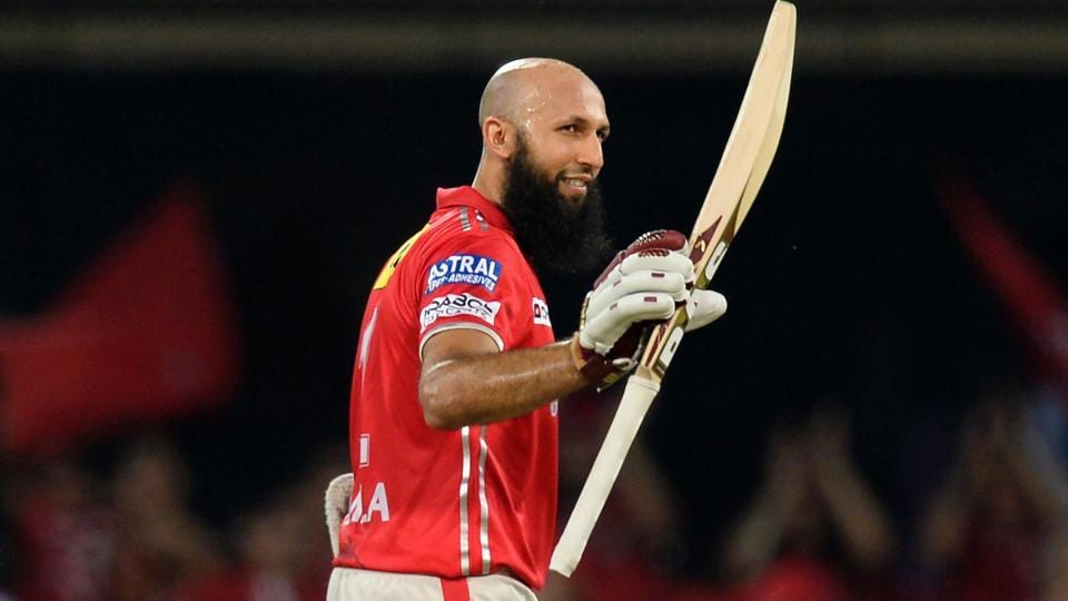 Kings XI Punjab's Hashim Amla celebrates after scoring a century during the 2017 Indian Premier League (IPL) T20 match against Mumbai Indians at the Holkar Stadium in Indore.