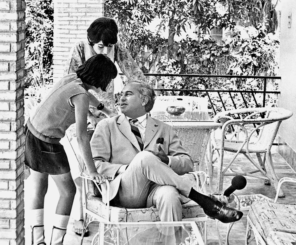 Zulfikar Ali Bhutto, President of Pakistan pictured at his home in Karachi with his children, Sanan Seema (14) and Shahnawaz (10) on April 30, 1971, during the Bangladesh Liberation War.