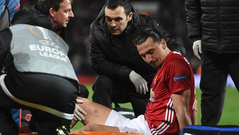 Manchester United's Swedish striker Zlatan Ibrahimovic gets treatment after injuring his knee during the UEFA Europa League quarter-final second leg clash against Anderlecht at Old Trafford in Manchester on Thursday.
