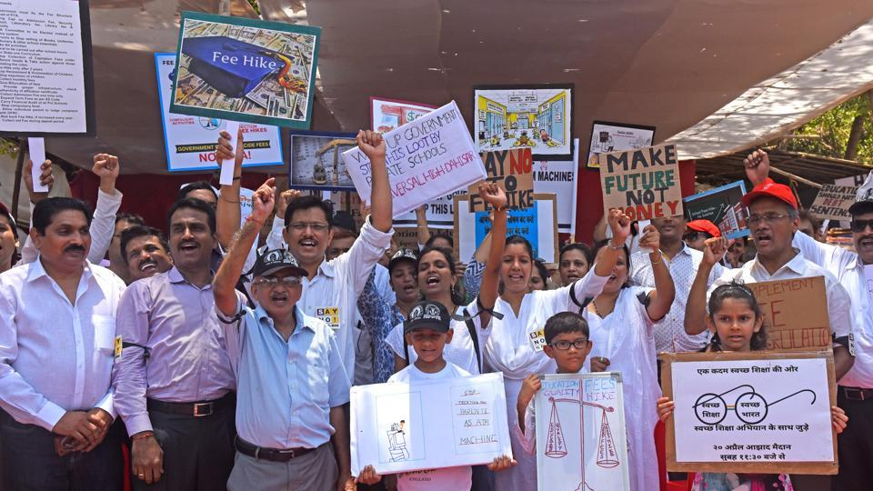 Parents and children protest against the exorbitant fee hike and collection of huge amount of un-approved and illegal fees by private schools at Azad maidan in Mumbai on Thursday.