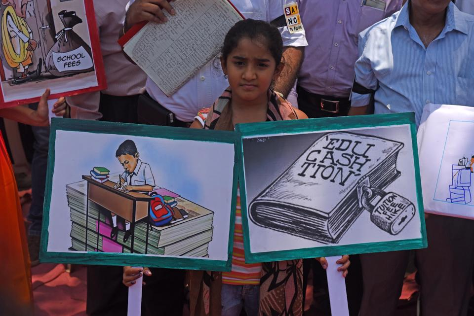 Parents and children protest against the exorbitant fee hike and collection of huge amount of un-approved and illegal fees by private schools at Azad maidan in Mumbai, India, on  April 20, 2017.