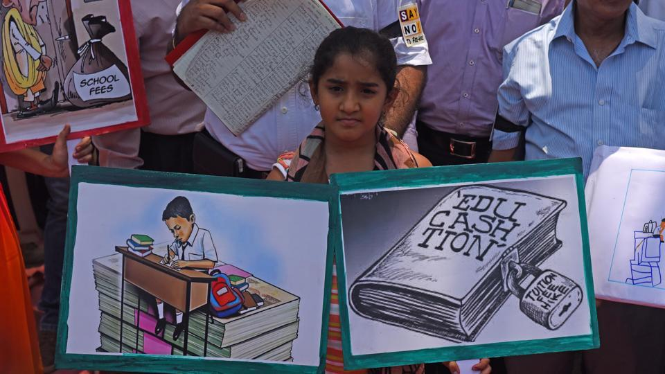 Parents and students protest at Azad Maidan in Mumbai on Thursday.