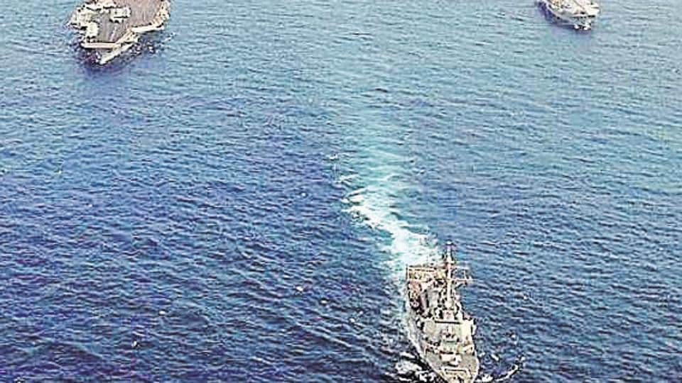 File photo of ships assigned to the USS Nimitz Carrier Strike Group and the Indian aircraft carrier Viraat underway in the Indian Ocean.