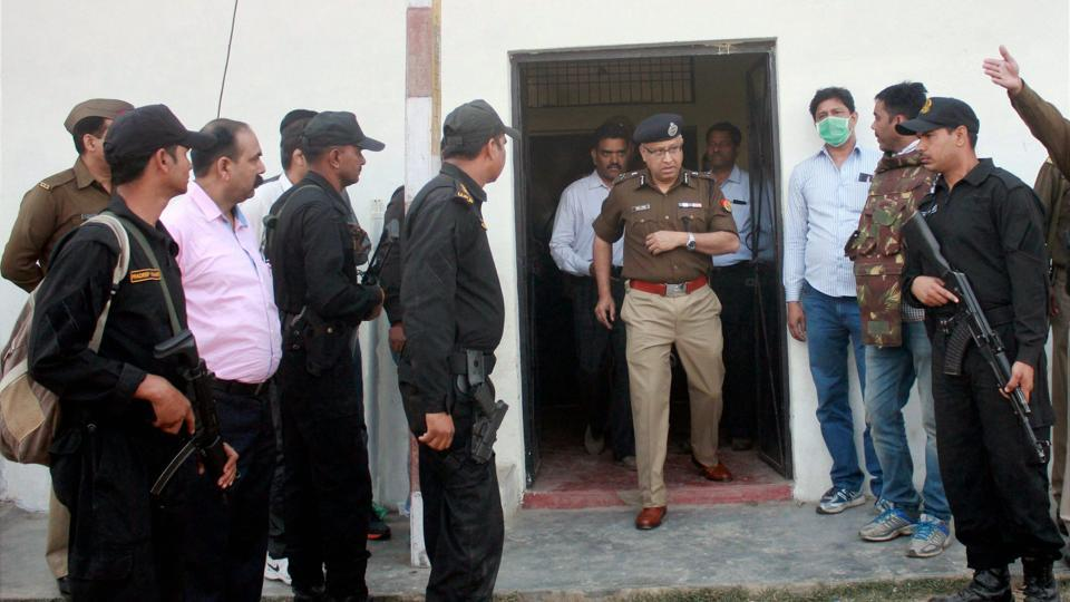 Outgoing UP DGP Javeed Ahmed comes out from a house where a suspected militant was killed in an encounter with security forces on the outskirts of Lucknow.
