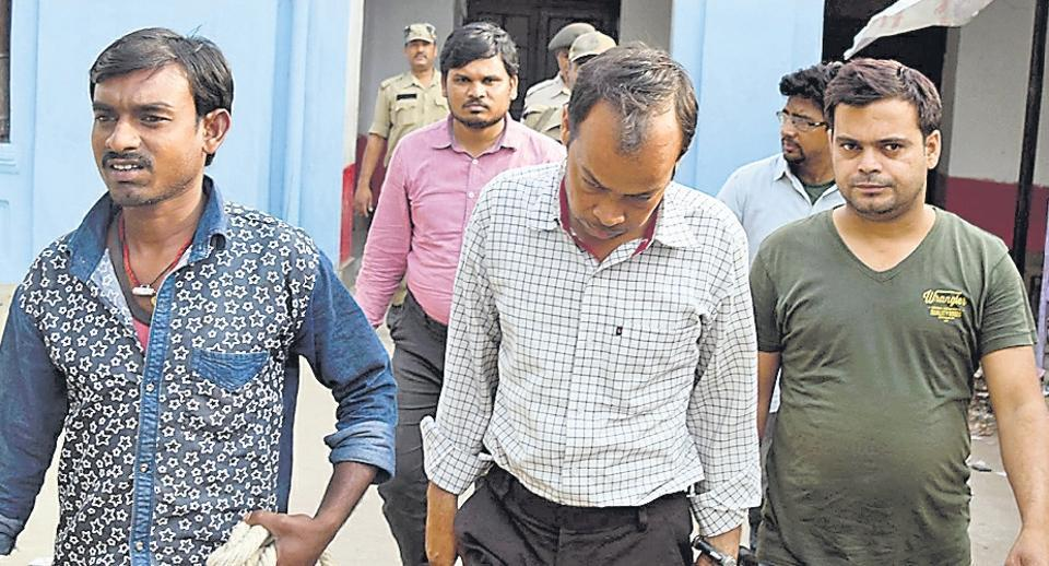 The arrested junior engineers of a power distribution firm at a Muzaffarpur court.