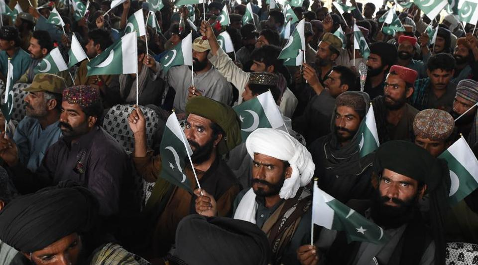 Baloch militants carry Pakistani national flags after they surrendered to Pakistani security forces in Quetta on April 21, 2017. Around 500 Baloch rebel militants on April 21 surrendered to Pakistan's government as Islamabad pursues its development agenda linked to the ambitious China Pakistan Economic Corridor (CPEC) in the southwest province.