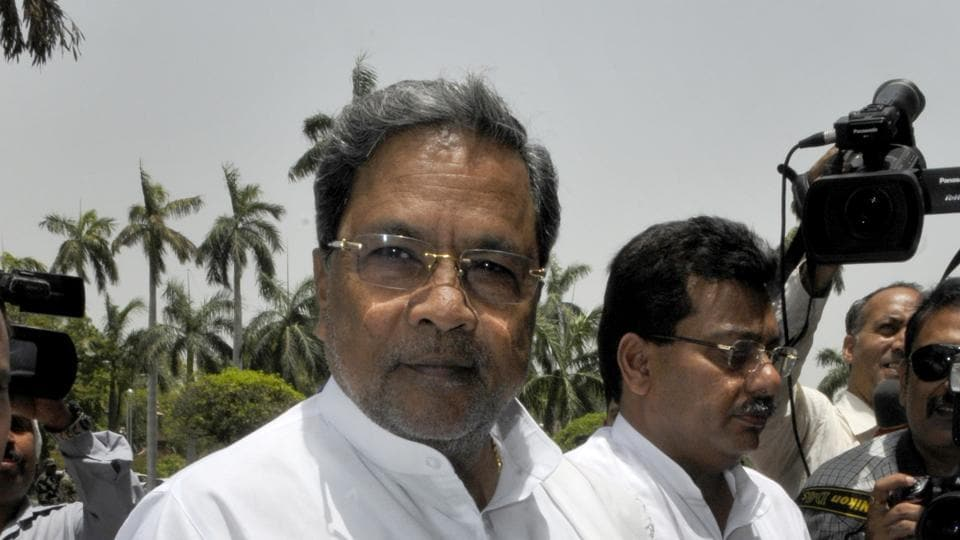 File photo of  Karnataka Chief minister Siddaramaiah allegedly ticked off an IPSofficer in public and seemingly ignored an MLAwho who wiped off a stain from his dhoti in Mandya on Thursday.