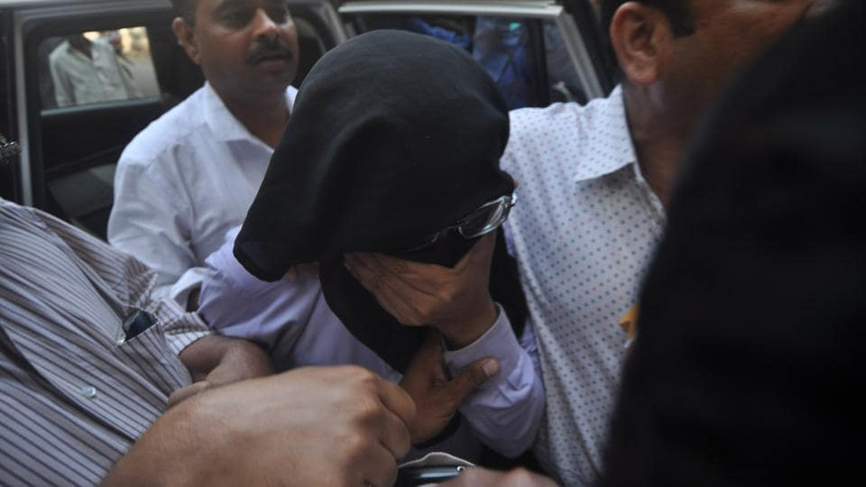 Sunil Kulkarni is presented before a court in Mumbai after he was arrested for trafficking and other charges.