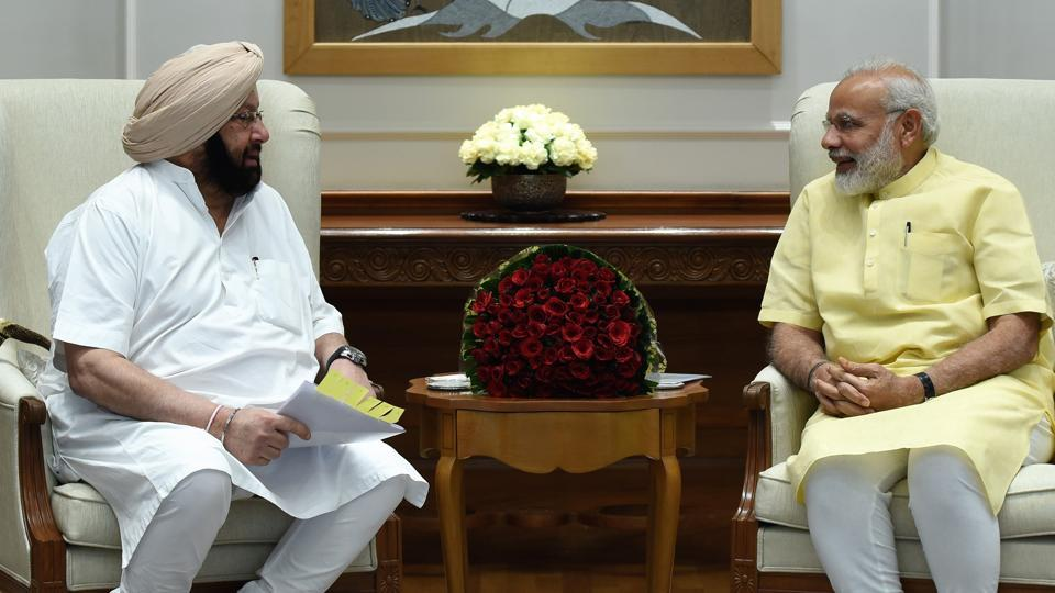 Chief minister Capt Amarinder Singh with Prime Minister Narendra Modi in Delhi on Thursday.