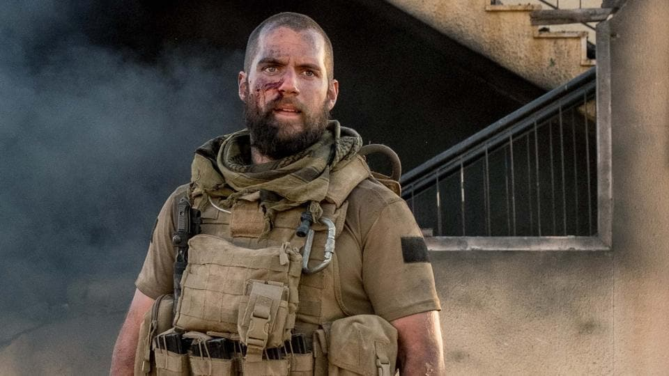 Sand Castle: With an impatiently done buzz cut, a beard that could, at some point, have been intended as a disguise, and a non-specific hillbilly accent, Cavill lumbers about, perpetually sweating, and barking orders in that same angry manner which confused so many Man of Steel fans.