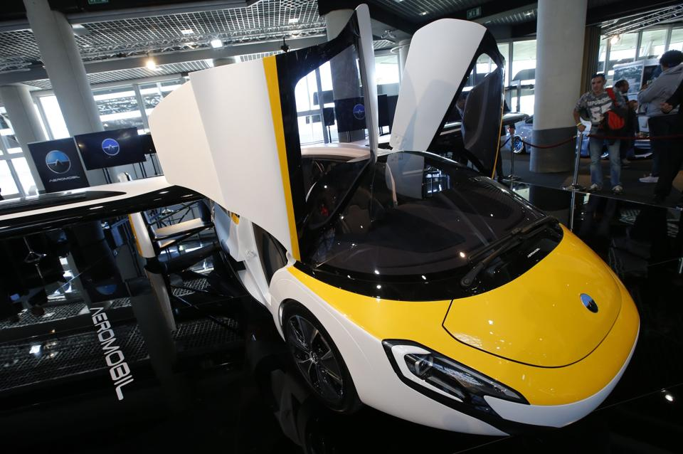 People look at the AeroMobil flying car during its unveiling at the Top Marques Monaco supercar show in Monaco.