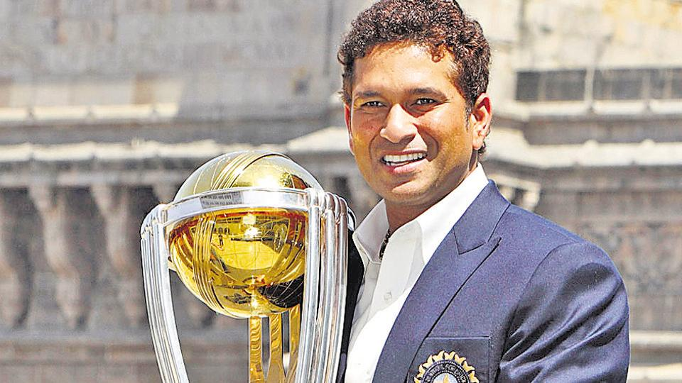 Sachin Tendulkar with the World Cup 2011 trophy in Mumbai.