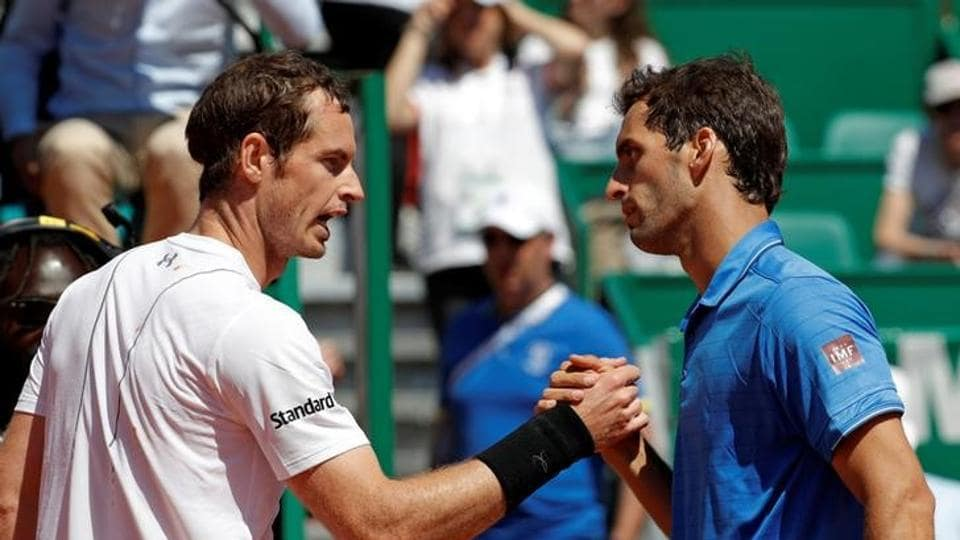 Albert Ramos-Vinolas of Spain (right) shakes hands with Andy Murray of Britain after winning the third round of the Monte Carlo Masters.