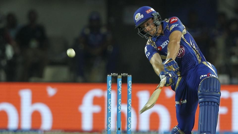 Jos Buttler 's 37-ball 77 overshadowed Hashim Amla's 104 as Mumbai Indians beat KingsXI Punjab by eight wickets in the 600th match of the Indian Premier League.