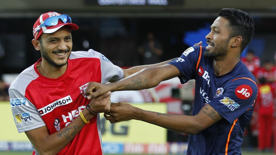 Axar Patel (left) of Kings XI Punjab shares a light moment with Hardik Pandya of Mumbai Indians before their 2017 Indian Premier League match at the Holkar Stadium in Indore on Thursday.  (BCCI)